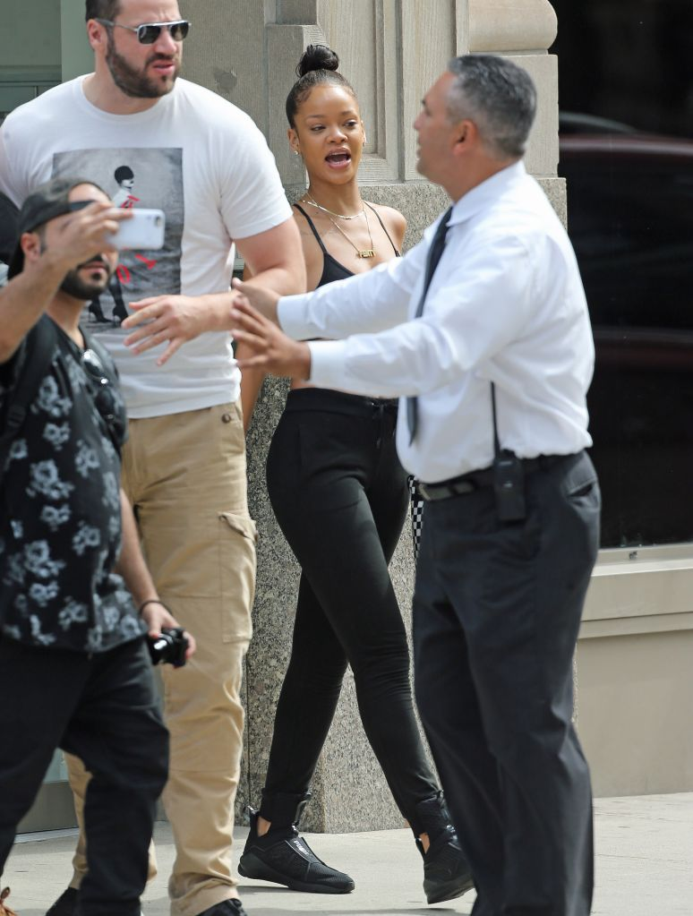 Rihanna flashes her tummy while leaving her apartment to head to rehearsals for the VMA's in New York City.