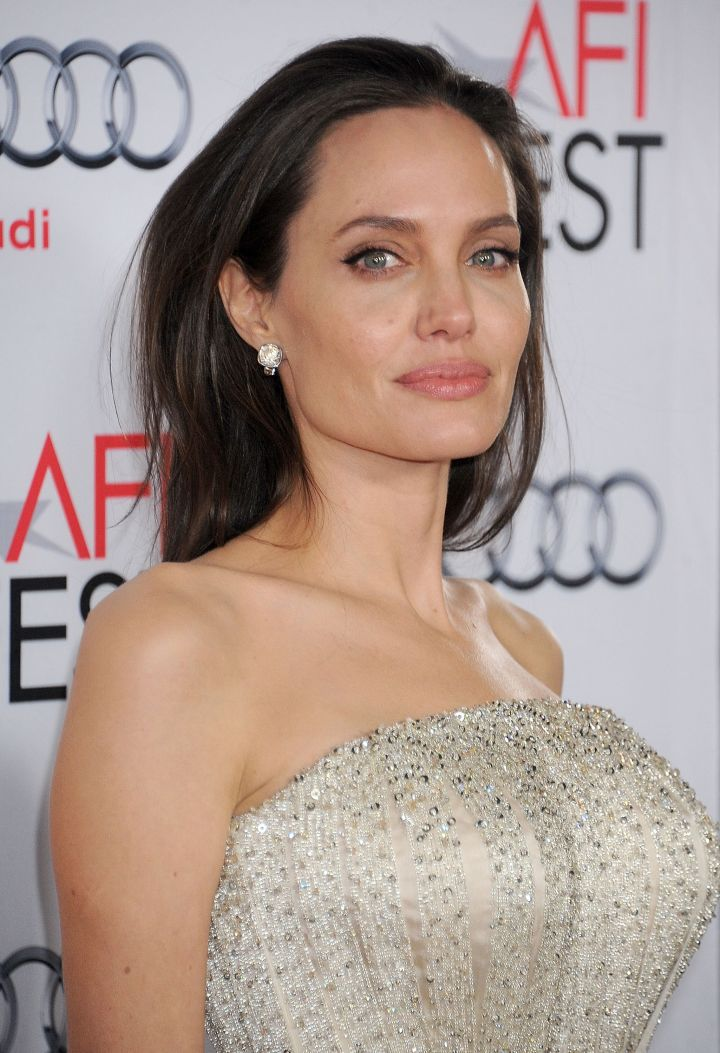 """Angelina Jolie has always been open about her bisexuality. She once told OK Magazine, """"I have loved women in the past and slept with them."""""""