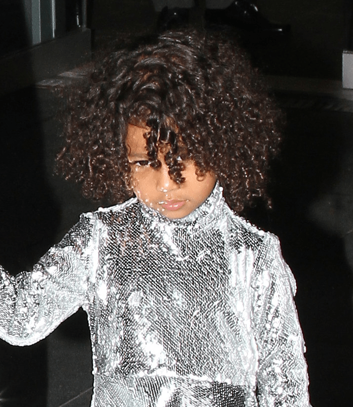 Kim Kardashian takes North West in silver sequined outfits out and about in NYC.