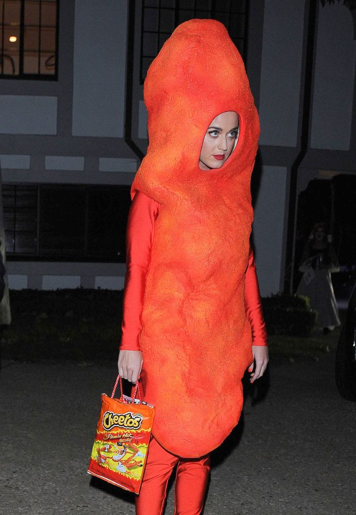 Thumbs up for Katy Perry's eclectic spirit, but out of all the snacks to be for Halloween, a Cheeto is not one.
