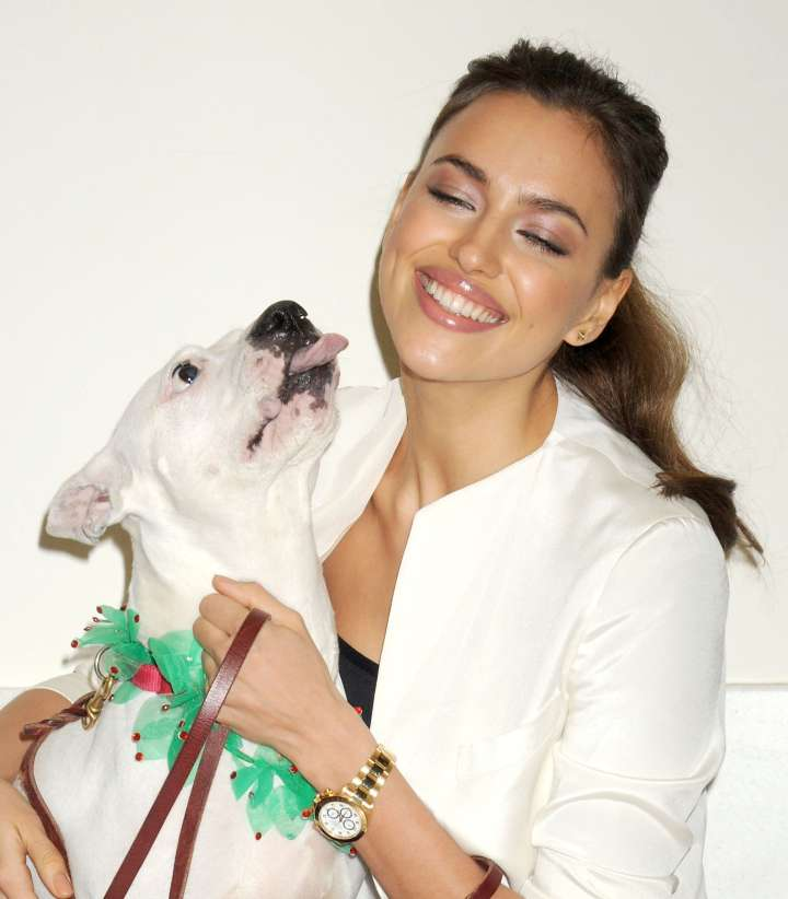 Irina Shayk steals a kiss from this heartthrob pit.