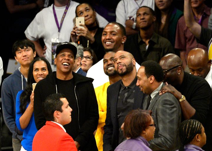 Kanye and Jay Z enjoy an L.A. Lakers game.