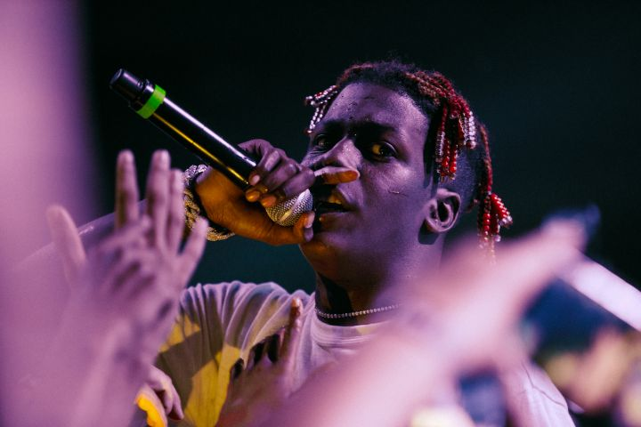 Freshman Lil Yatchy gets into the crowd to feel all the love he got while performing Broccoli at Complexcon