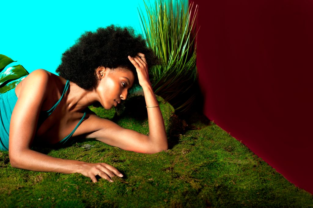 Woman with Afro in colorful nature room