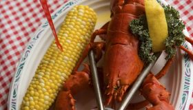 Lobster with corn and drawn butter, overhead view