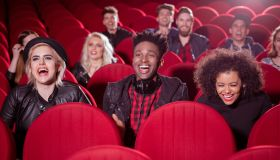 Multi ethnic group of people in the cinema