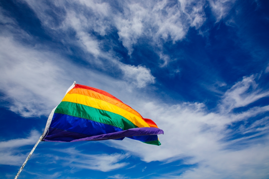 Rainbow flag waiving in the wind in South Beach, Miami