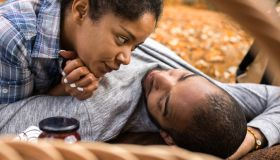 African American couple in love relaxing in nature during autumn day.