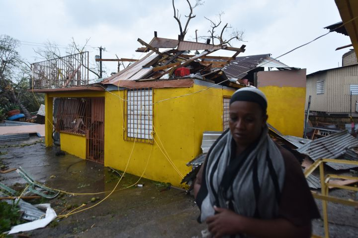 San Juan, PR: Residents begin the recovery process after Hurricane Maria damaged their homes.