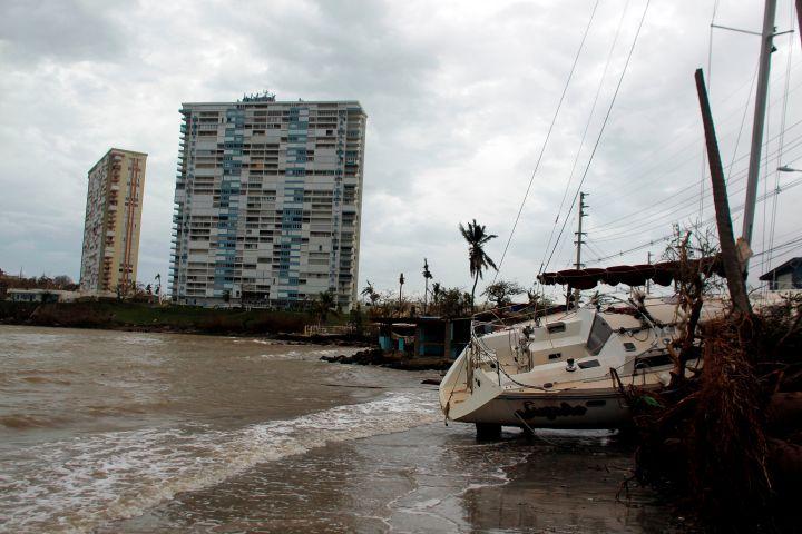 Fajardo, PR: A damaged sail boat washed ashore following Hurricane Maria.
