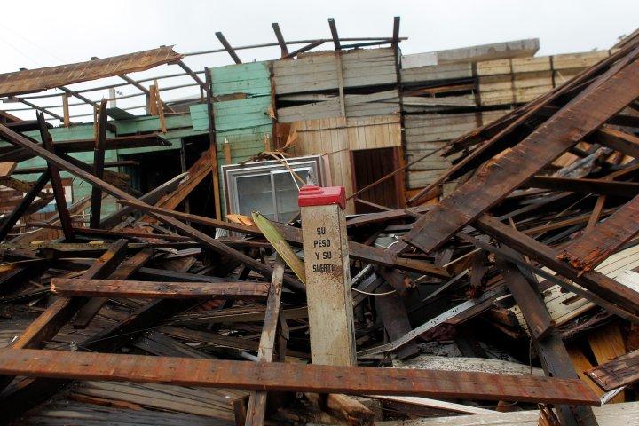 Fajardo, PR: A coin weighing scale lies between debris from a destroyed bar.