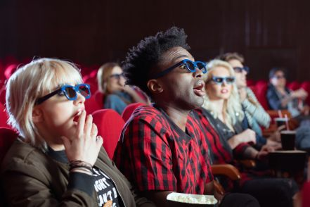 Young people in 3D movie theater
