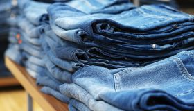 jeans on shelves in a clothing store
