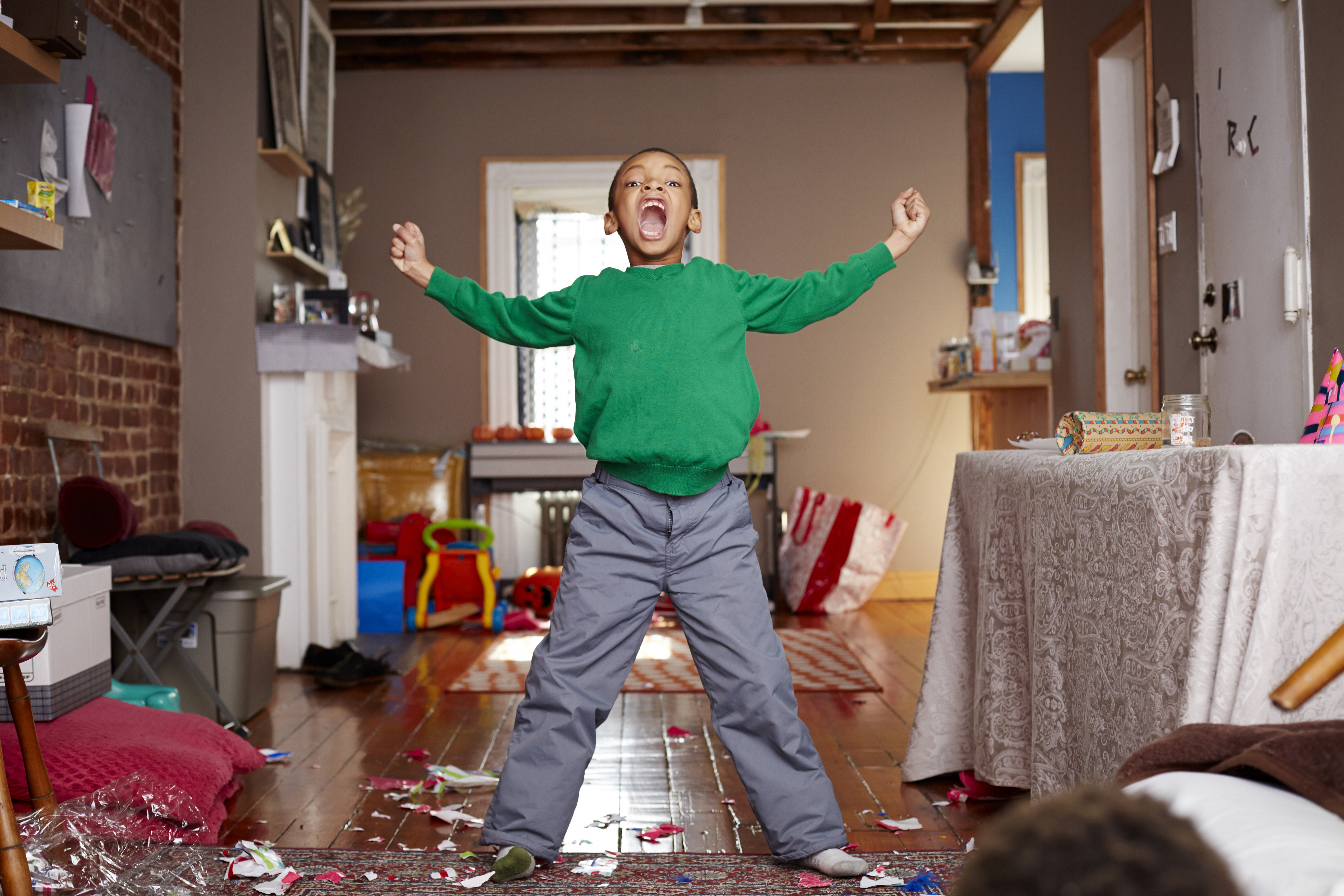 Black boy shouting in living room
