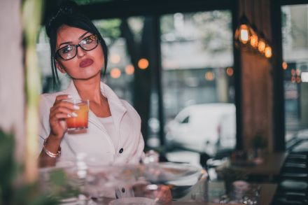 Young woman relaxing at the bar