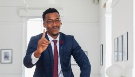 Black man gesturing in gallery