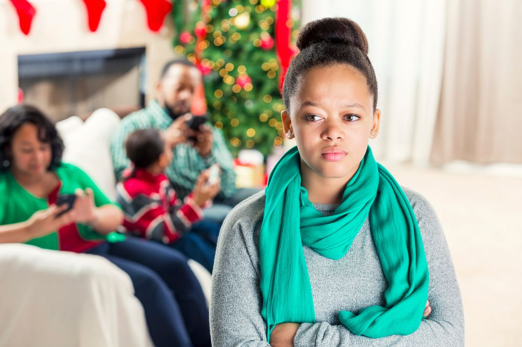 Teenage girl is ignored by family at Christmastime