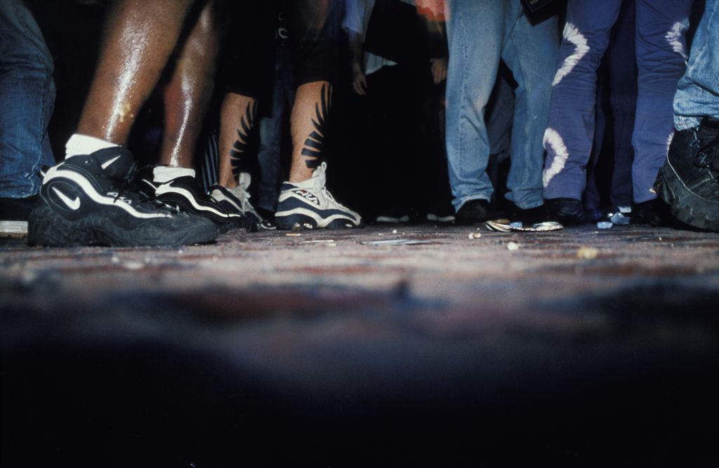 Close-up of trainers on the dancefloor. Free / Squat Parties 1997 - 1998