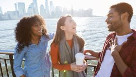 Young adults laugh while vacationing together