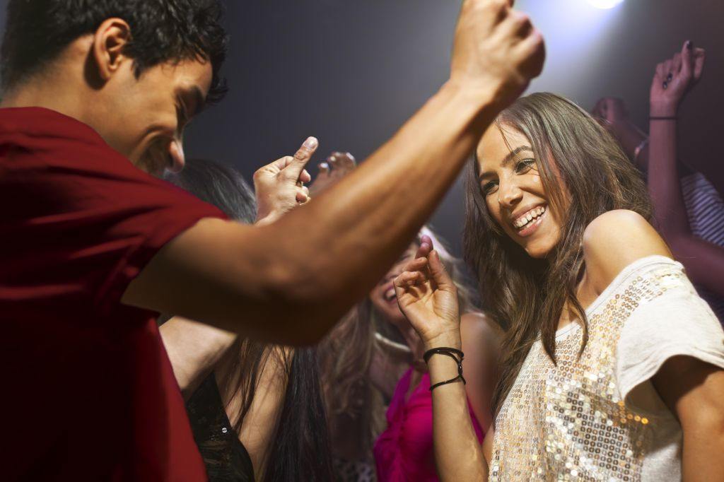 young couple dancing together at a nightclub