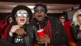 Multi ethnic young couple in 3D movie theater