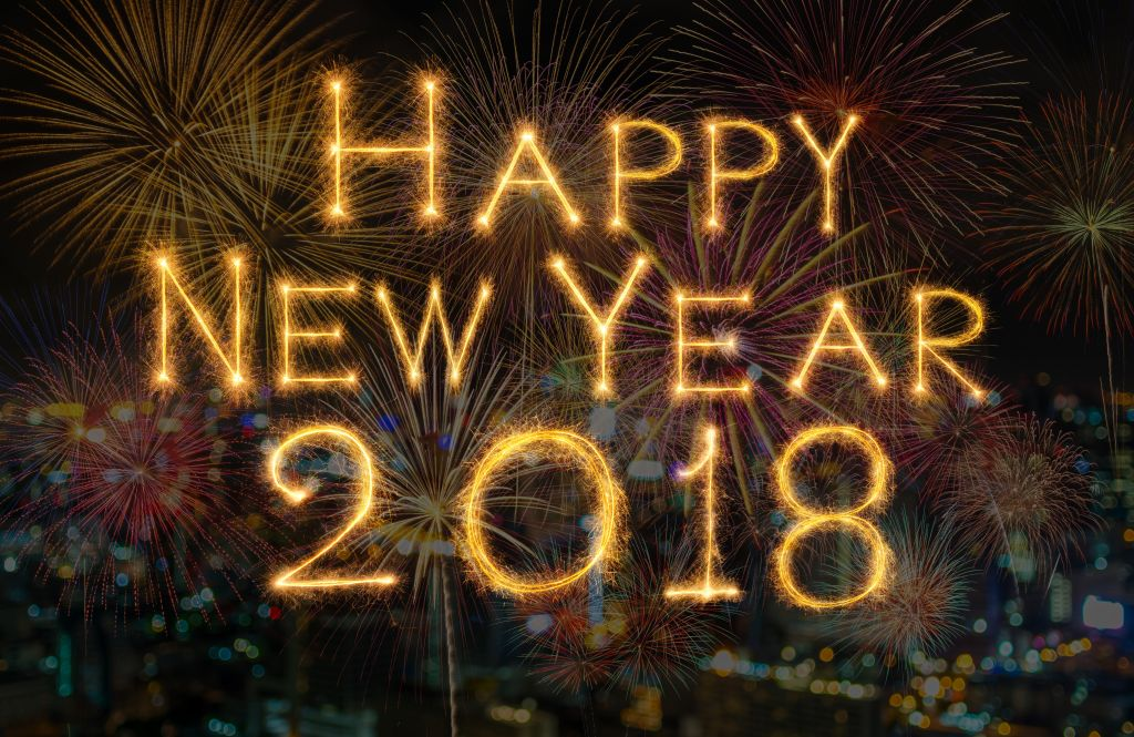 celebration and greeting cards concept, Happy new year 2018 written with Sparkle firework on fireworks with dark background