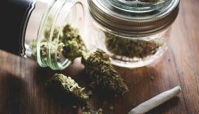 Marijuana in a jar. Cannabis joint. Medical or recreative