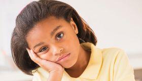 Bored girl (6-7) doing homework