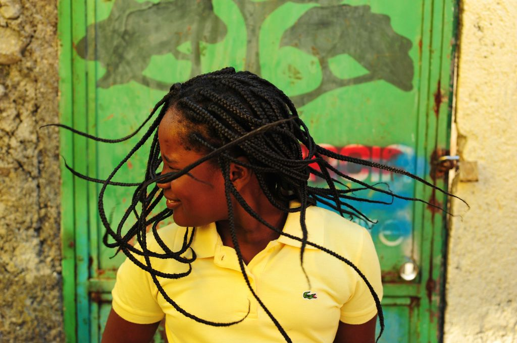 Girl dancing and shaking her braids