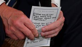 WASHINGTON, DC - FEBRUARY 21: President Donald Trump holds a c