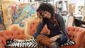 Mixed race artist sitting in studio