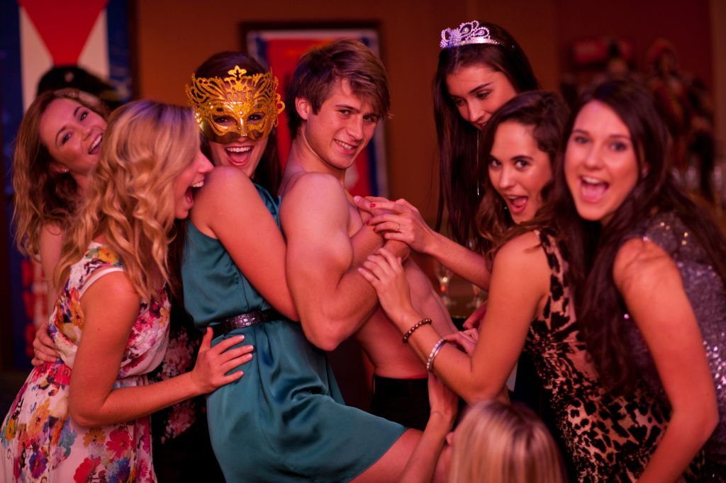 Young women at hen party with male stripper