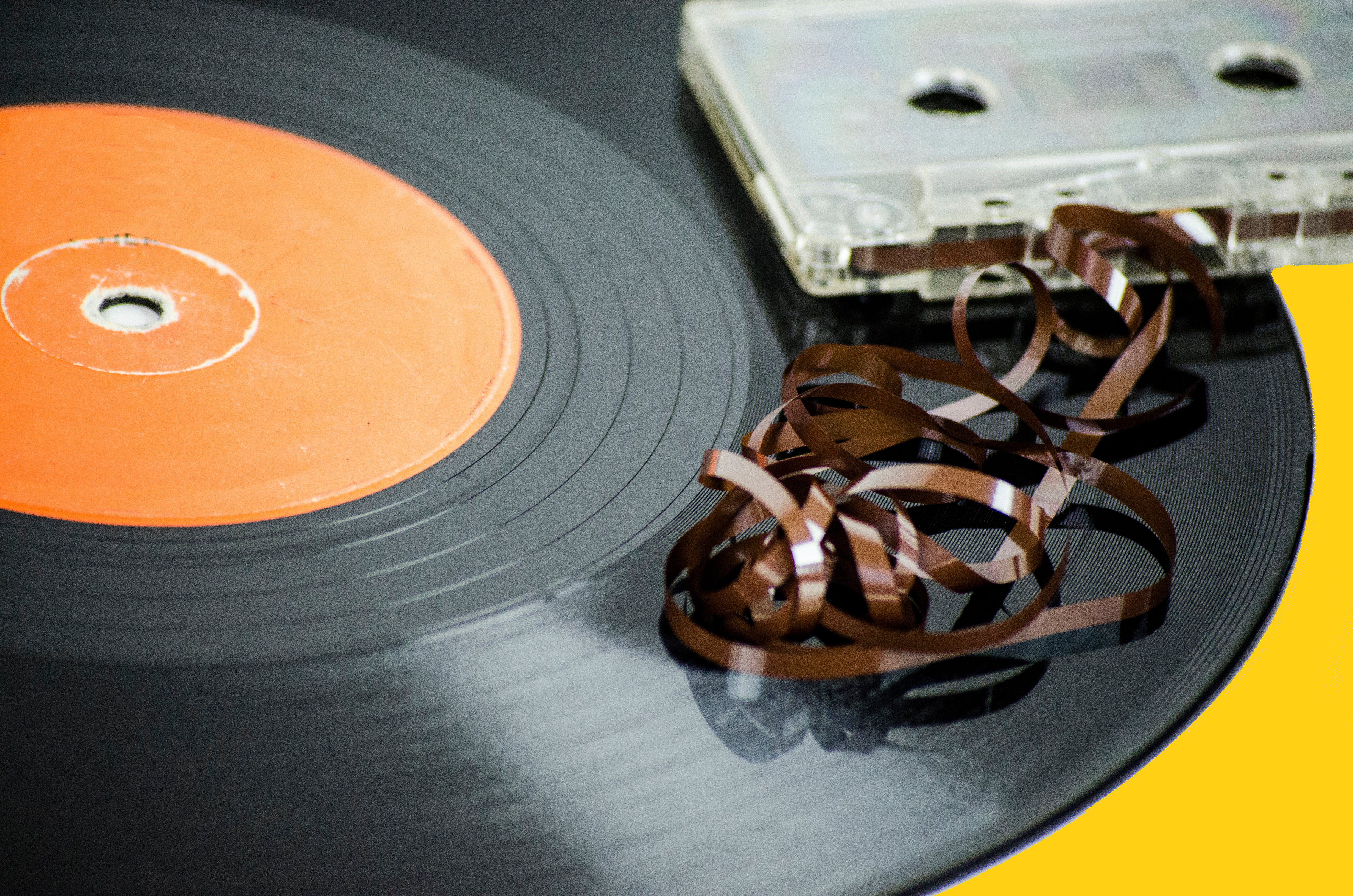 Close-Up Of Record Player Needle And Audio Cassette