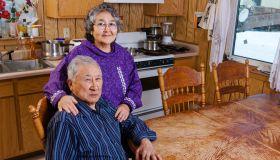 Elder Alaska native couple in their kitchen sitting at the kitchen table, Noatak, Arctic Alaska, USA, Winter
