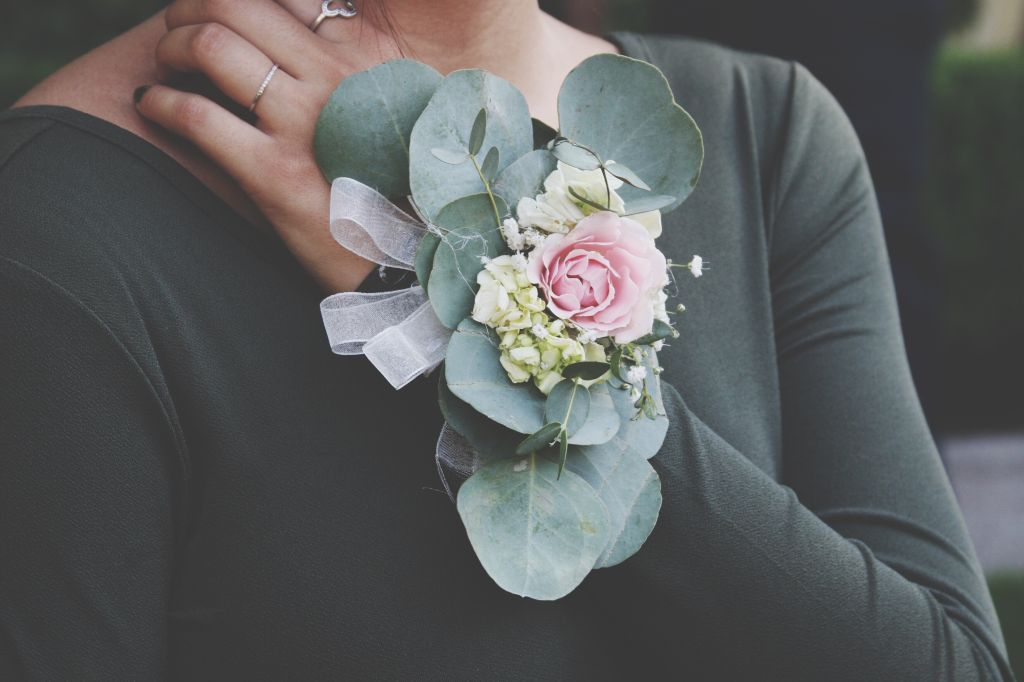 Close-Up Of Hand With Corsage