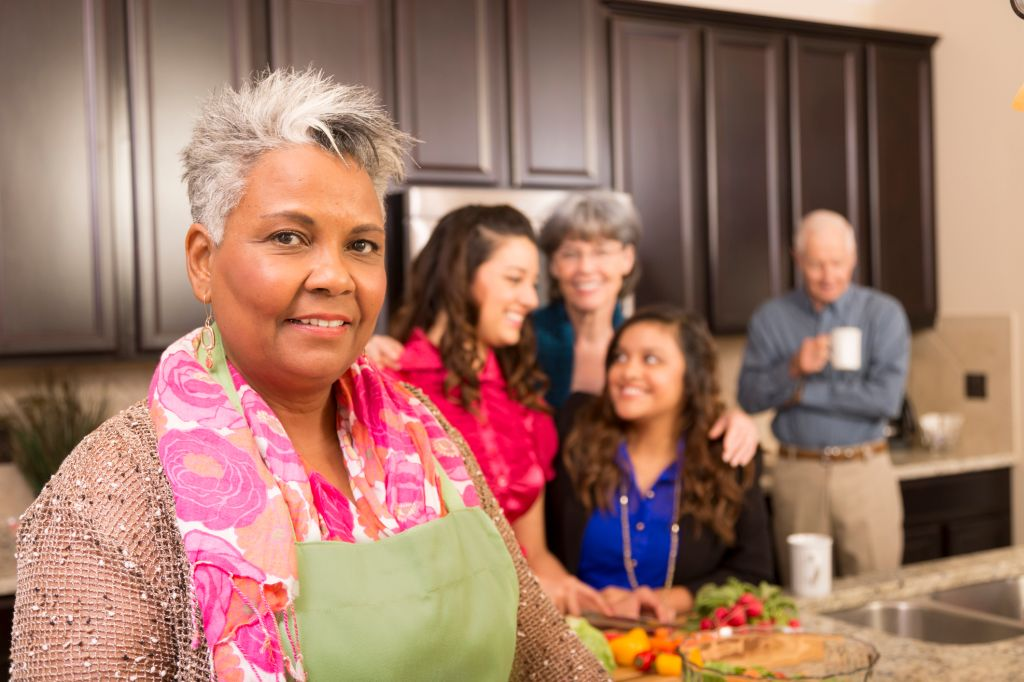Relationships: Senior woman, family and friends cook in home kitchen.