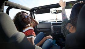 Women in jeep enjoying road trip