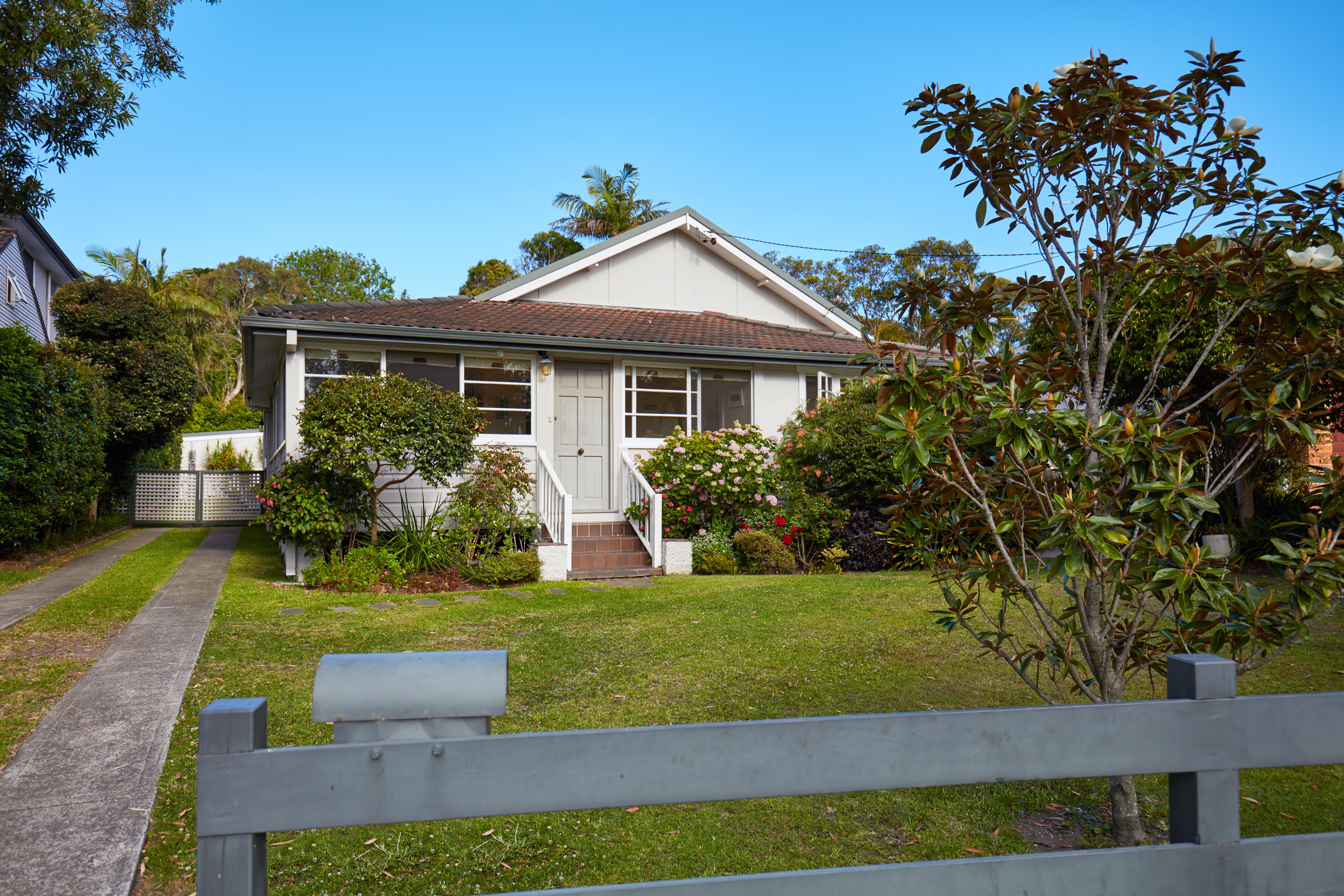 Australian house from fence in suburbs against sky