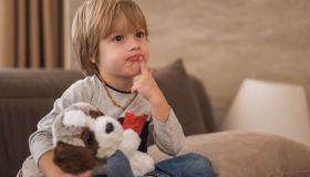 Serious boy watching TV