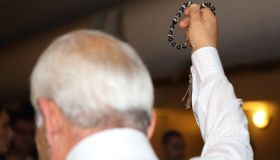 Rear View Of Priest With Worry Beads During Wedding Ceremony