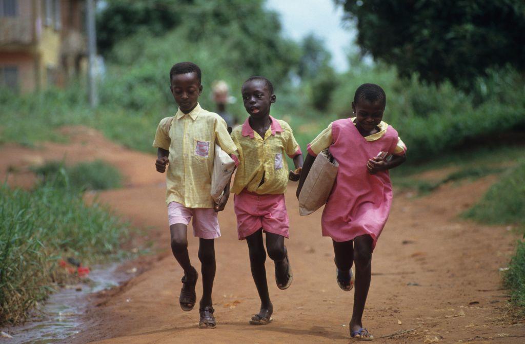 CHILDREN GOING TO SCHOOL, NIGERIA. Primary school in Benin city.