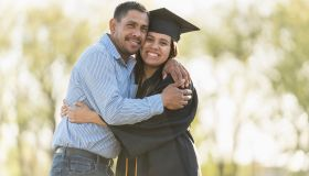 Father and daughter hugging at graduation