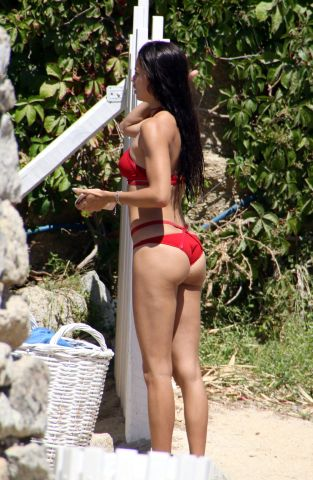 Adriana Lima relaxes on the beach in Mykonos