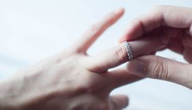 A woman is wearing her own wedding ring
