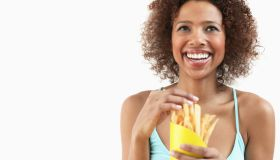 Woman Eating French Fries
