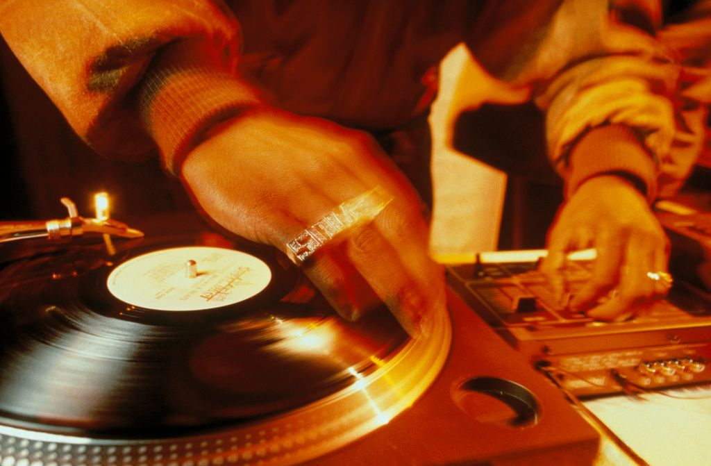 Close-up of Jungle Brothers DJ, Sammy B scratching in the UK, 1990s