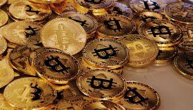 Physical version of Bitcoin coin aka virtual money.