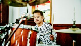 Young boy playing drum set