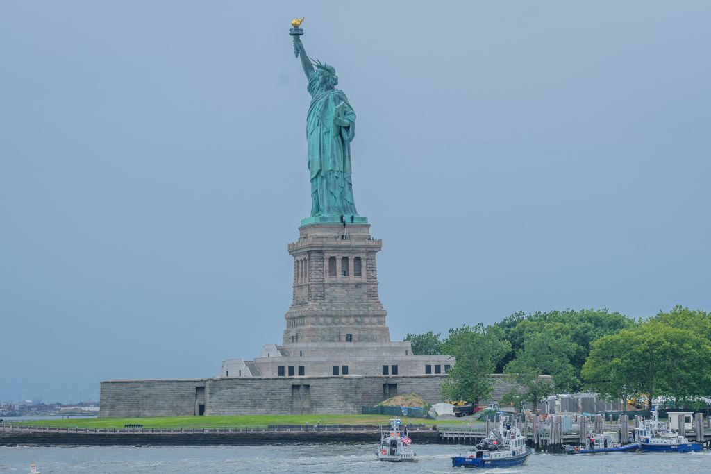 Liberty Island was evacuated because of a person climbing...