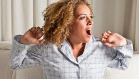 Woman stretching and yawning